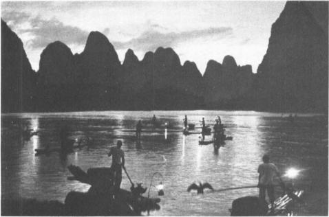 Fishing at dusk on the Li-Kiang River